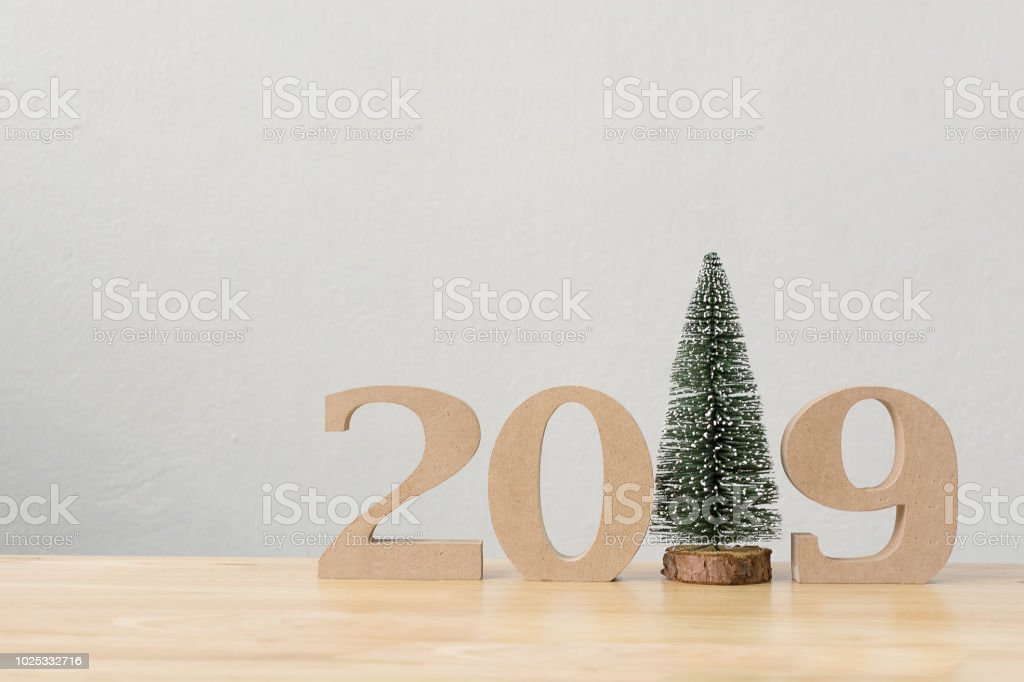 New years resolution 2019 concept. Wooden year number and christmas...