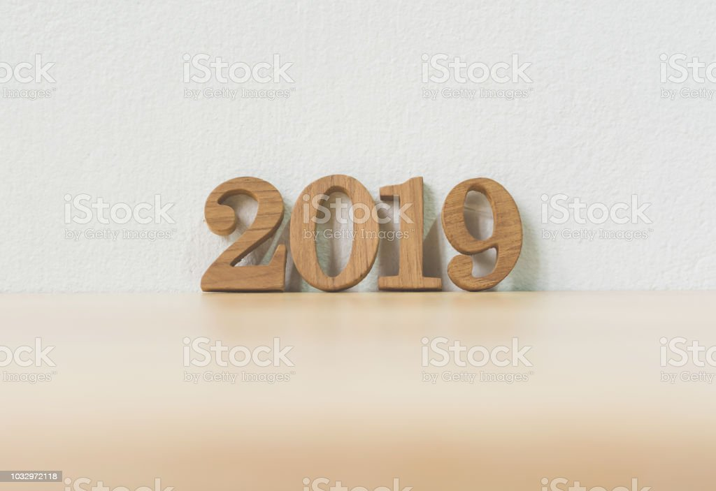 New years resolution 2019 concept. Wooden year number on table