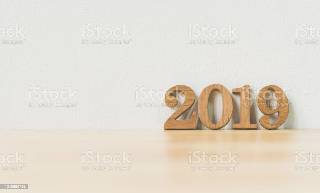 New years resolution 2019 concept. Wooden year number on table with...