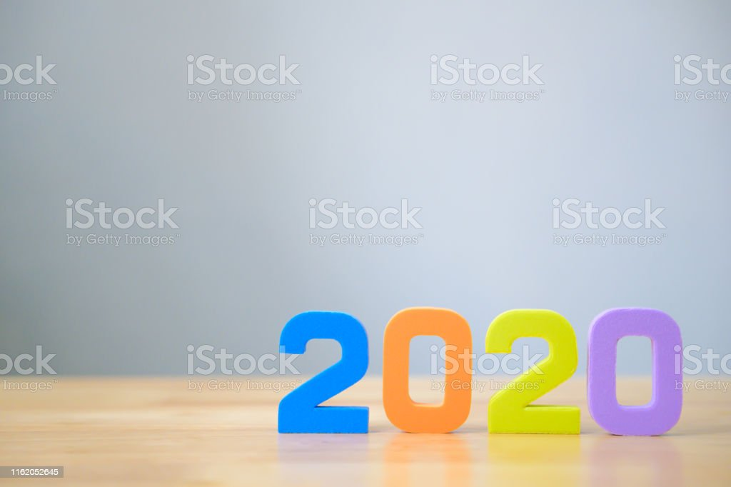 New years resolution 2020 concept. Colourful number on table with...