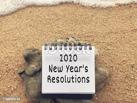 2020 New Year's Resolutions written on a notepad.