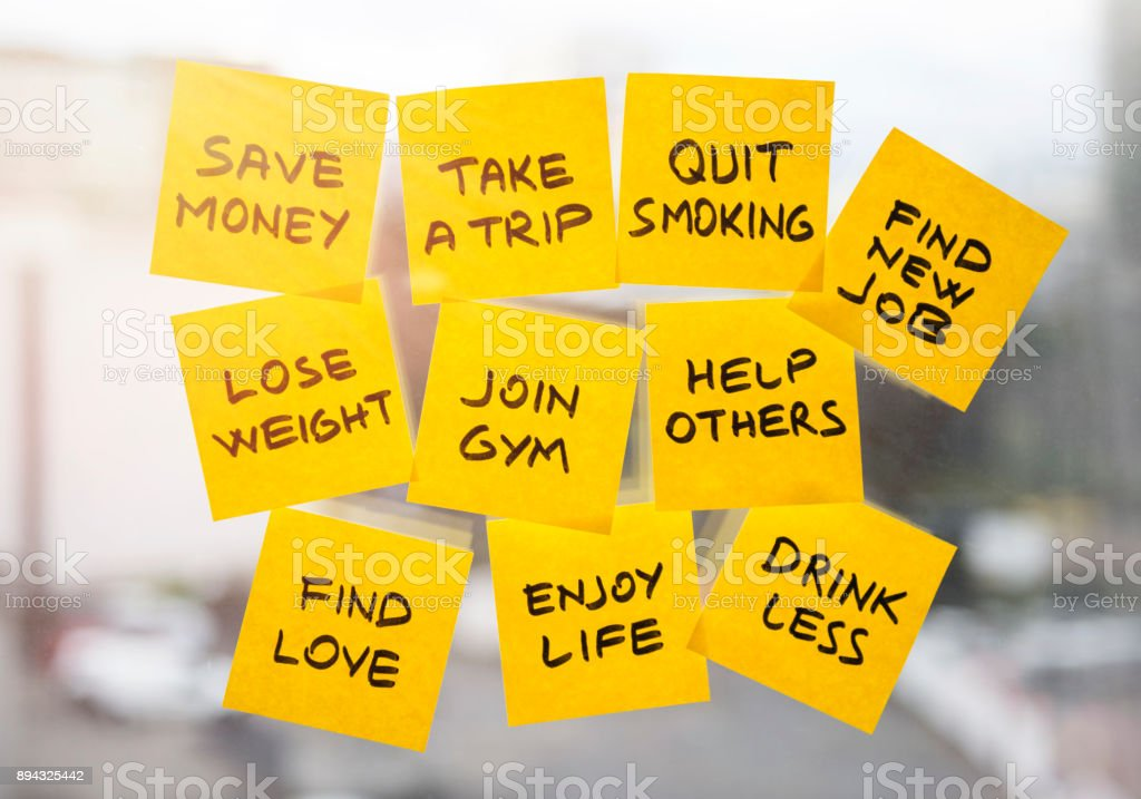 new years resolution note papers on the window stock photo