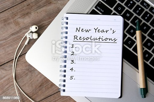 istock New Year's Resolutions List on Notepad 868911980