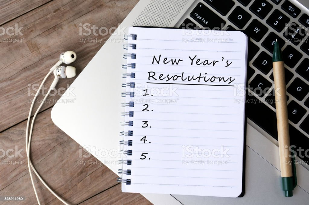 New Year's Resolutions List on Notepad stock photo