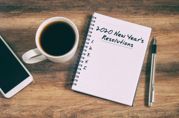 2020メモ帳の新年の抱負のテキスト - 決意 ストックフォトと画像