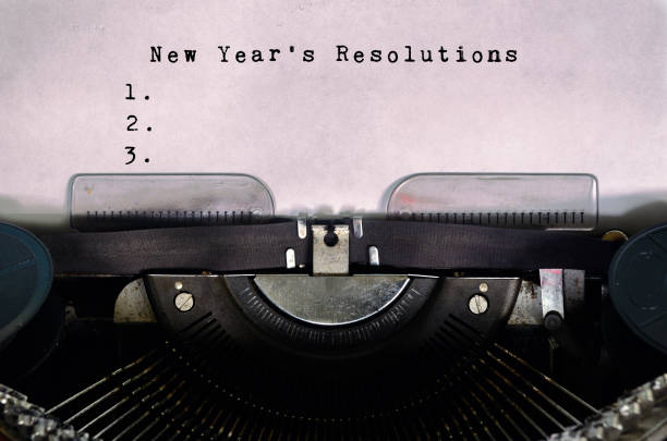new year's resolutions typed on a vintage typewriter - new years day stock pictures, royalty-free photos & images
