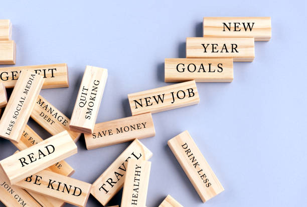 new year's resolutions written on wood blocks - new years day stock pictures, royalty-free photos & images