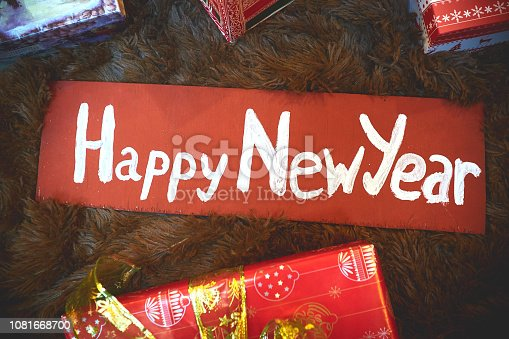 a new year's sign on a wooden retro signboard
