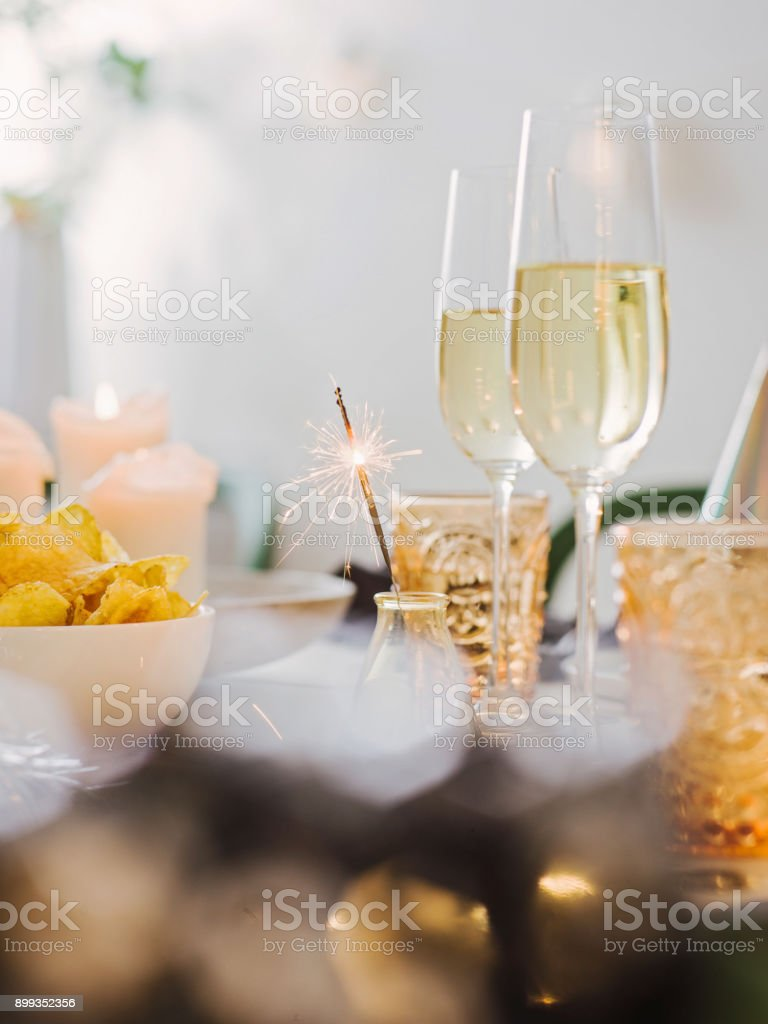 New years still life dinner place setting with champagne stock photo