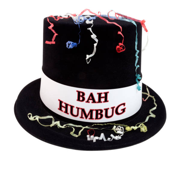 New Year's Top Hat Isolated BAH HUMBUG black New Year's costume top hat with confetti. coot stock pictures, royalty-free photos & images