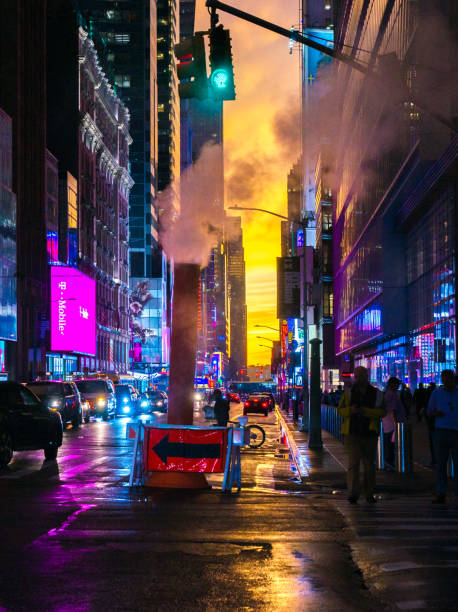 New York 42nd Street in Colorful Lights with Orange Sunset Background