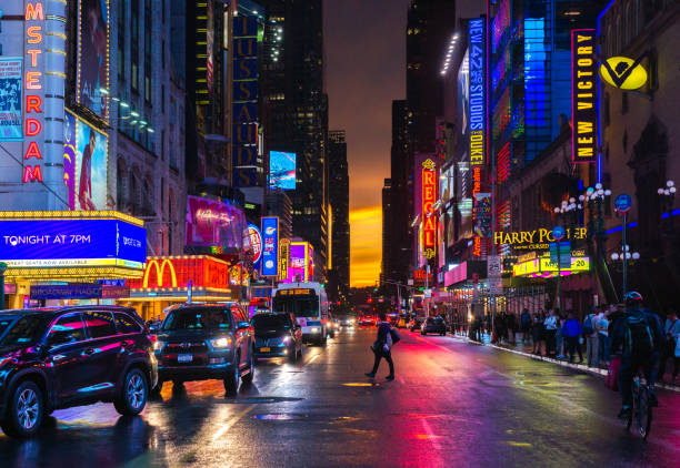 New York 42nd Street in Colorful Theatre Lights with Orange Sunset Background