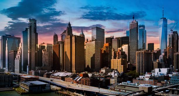 New York at sunset New York skyscrapers view at sunset lower manhattan stock pictures, royalty-free photos & images