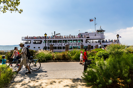 New York, USA - August 24, 2015: Views to the Cruise Boats to Liberty and Ellis Island from New York on August 24, 2015. The Cruises are popular for tourist to visit the Statue of Liberty ind New York.