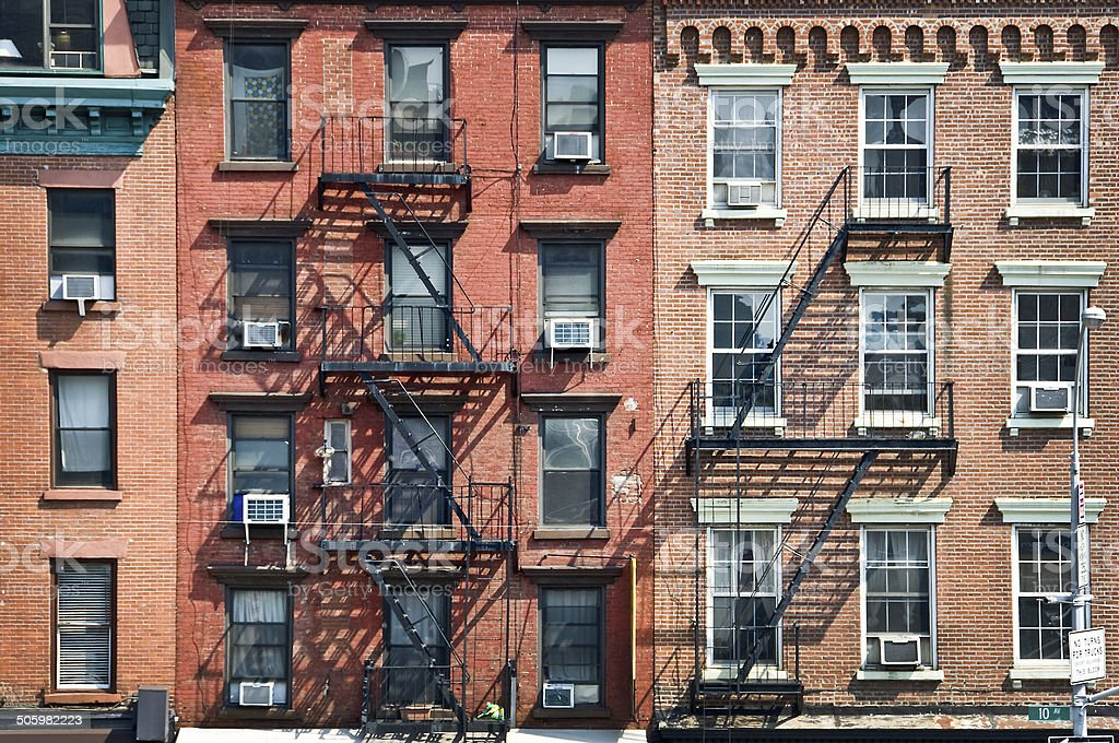 New York brick buildings with outside fire escape stairs, USA stock photo