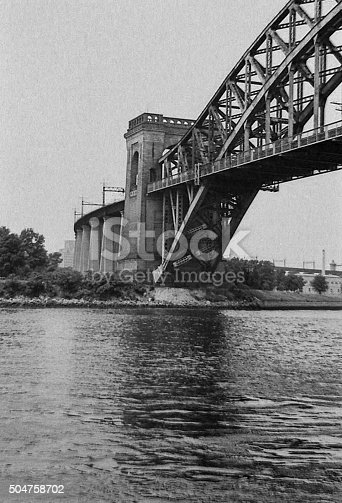 New York, New York, June 22, 1964, Bridge in Greater New York.  View is from a the other side of the river, looking up at the bridge.  The construction is plainly visible.