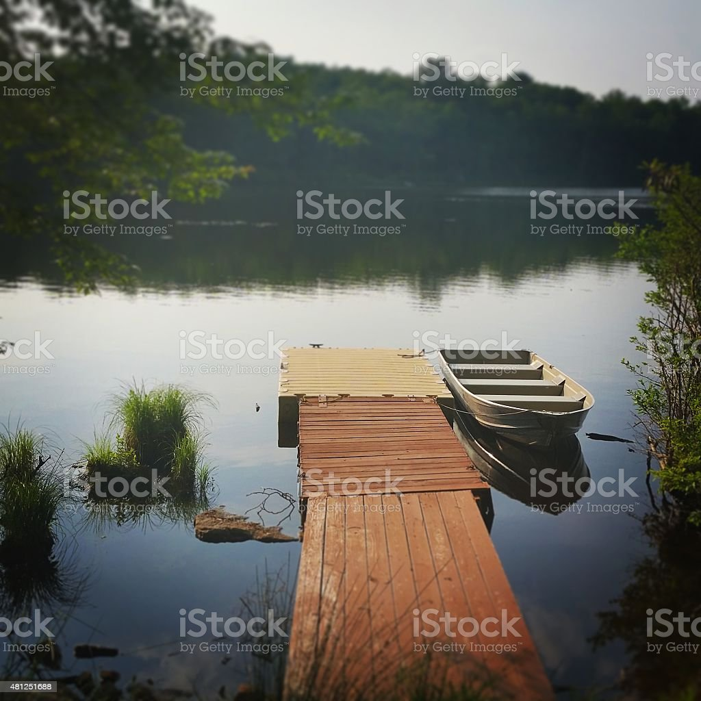 New York Catskill Mountains Scenic Lake with Dock and Rowboat stock photo