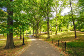 New York, United States - October 7, 2017: people walking in a footpath at Central Park in autumn. Manhattan. New York City. USA