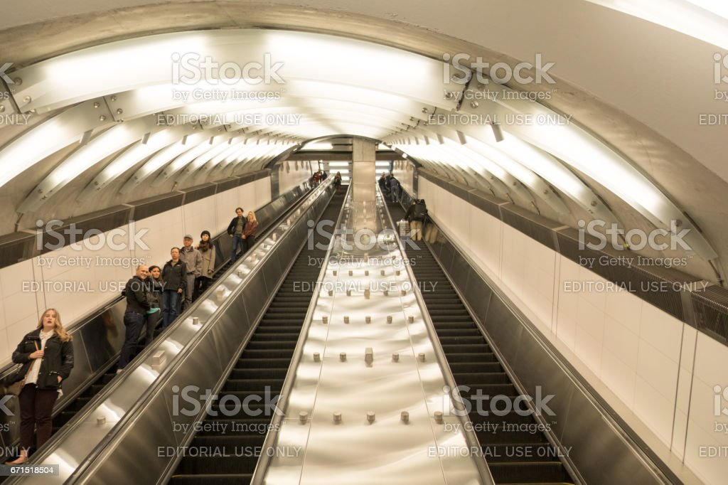 New York City - 15 April 2017:People riding the escalator down the tunnel to the New York Subway.  New 86th Street subway station on the Upper East Side, 2nd Avenue, Manhattan. stock photo