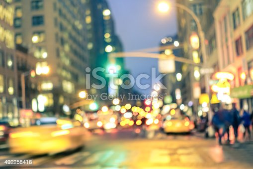 1154996700istockphoto New york City abstract rush hour - Defocused taxi cabs 492258416