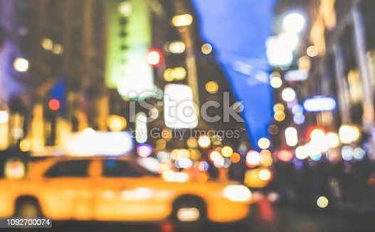 New York City abstract rush hour - Defocused yellow taxicab car and traffic jam on 5th avenue in Manhattan downtown at blue hour - Blurred bokeh postcard on retro vintage nostalgic filtered look
