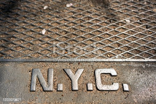The initials for New York City on a steel manhole cover in Manhattan.