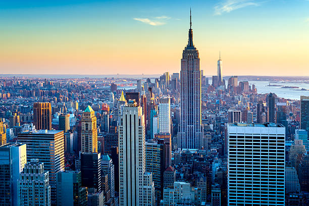 New York City Aerial Skyline at Dusk, USA Looking over Manhattan towards the Empire State Building in New York City, USA. new york state stock pictures, royalty-free photos & images