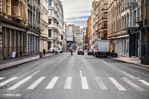 istock New York City asphalt road on busy intersection streets with car traffic at daytime 1133502463