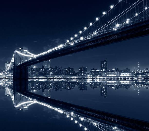 New York City, Brooklyn Bridge at night in blue tones stock photo