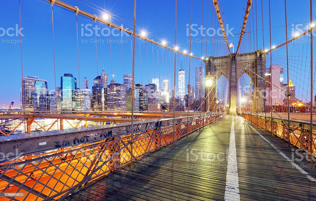 New York City, Brooklyn Bridge at night, USA stock photo