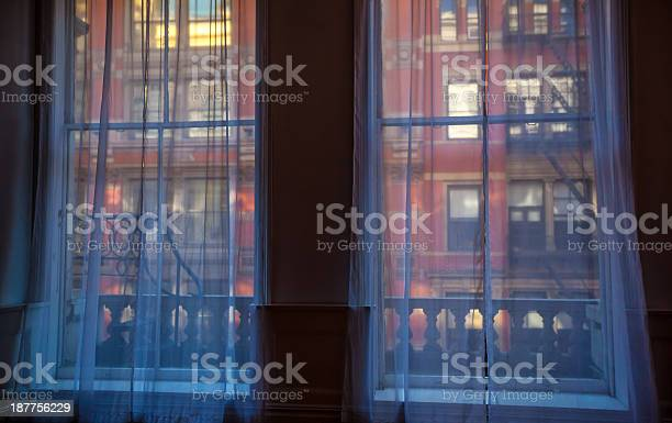 New York City building Glimpse at a New York City building as seen from a window. Apartment Stock Photo