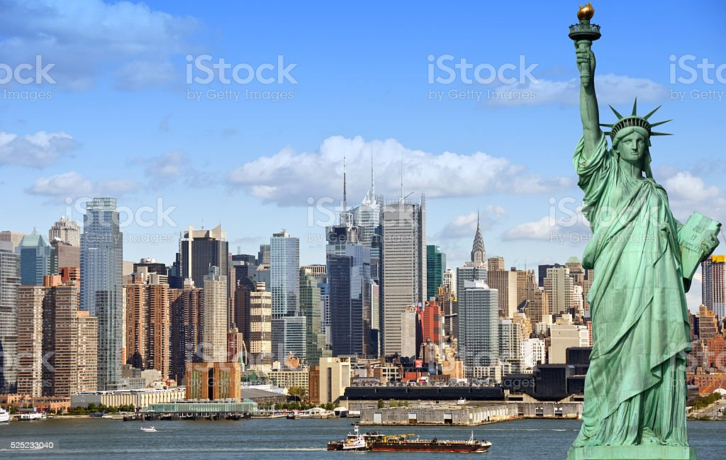 new york city cityscape skyline with statue of liberty stock photo