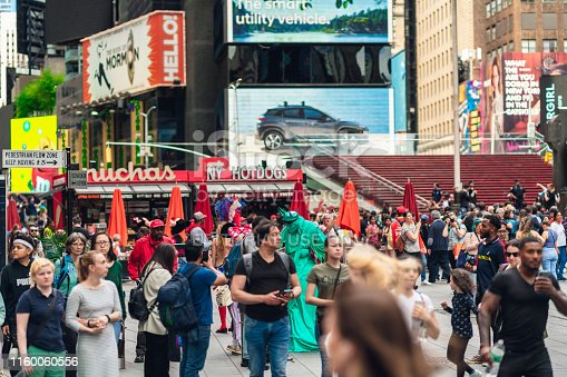 istock New York City, Crowded Time Square. Billboards, Neon Art, Street Artists, and Tourists 1160060556