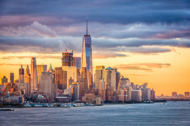 New York City Dawn New York City financial district on the Hudson River at dawn. manhattan financial district stock pictures, royalty-free photos & images