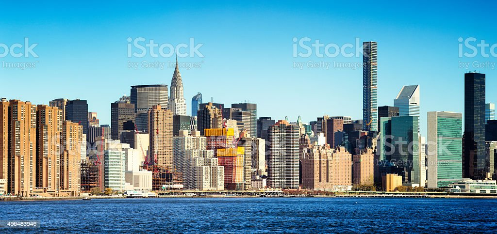 New York City East side panoramic skyline blue sky stock photo