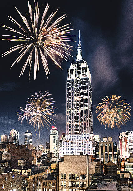 new york city empire state for the new year fireworks - new york new year stock-fotos und bilder
