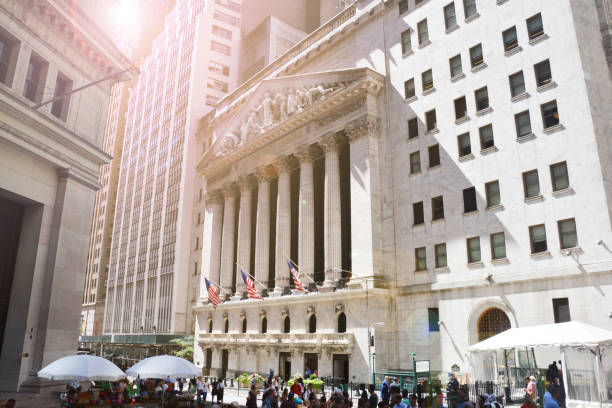 new york city, famous wall street and historic stock exchange building under the sunlight, usa - wall street lower manhattan stock pictures, royalty-free photos & images