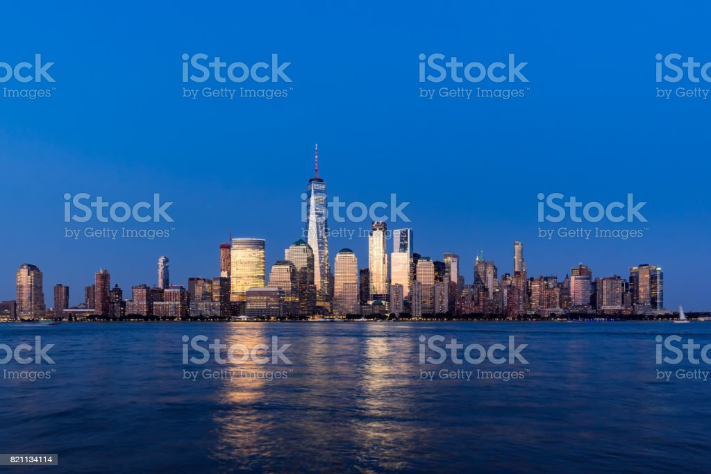 New York City Financial District skyscrapers and Hudson River at dusk. Lower Manhattan stock photo