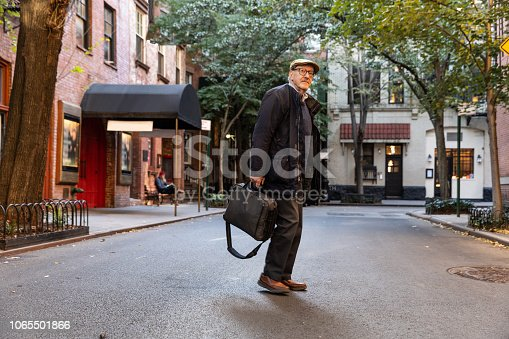 Senior caucasian man walking down the streets in New York city enjoying his free time.