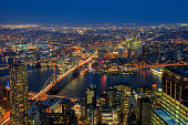 Aerial view of Lower Manhattan, Brooklyn Bridge and Brooklyn at Night, New York City