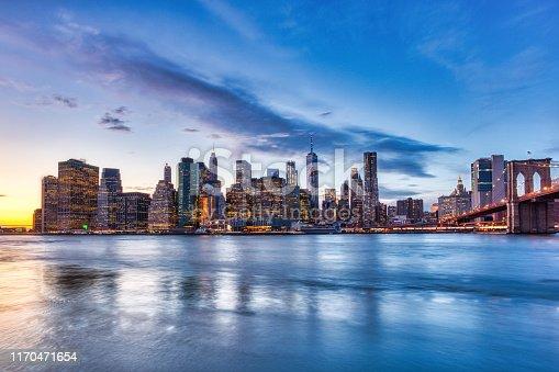 New York City Lower Manhattan with Brooklyn Bridge at Dusk, View from Brooklyn, New York, USA