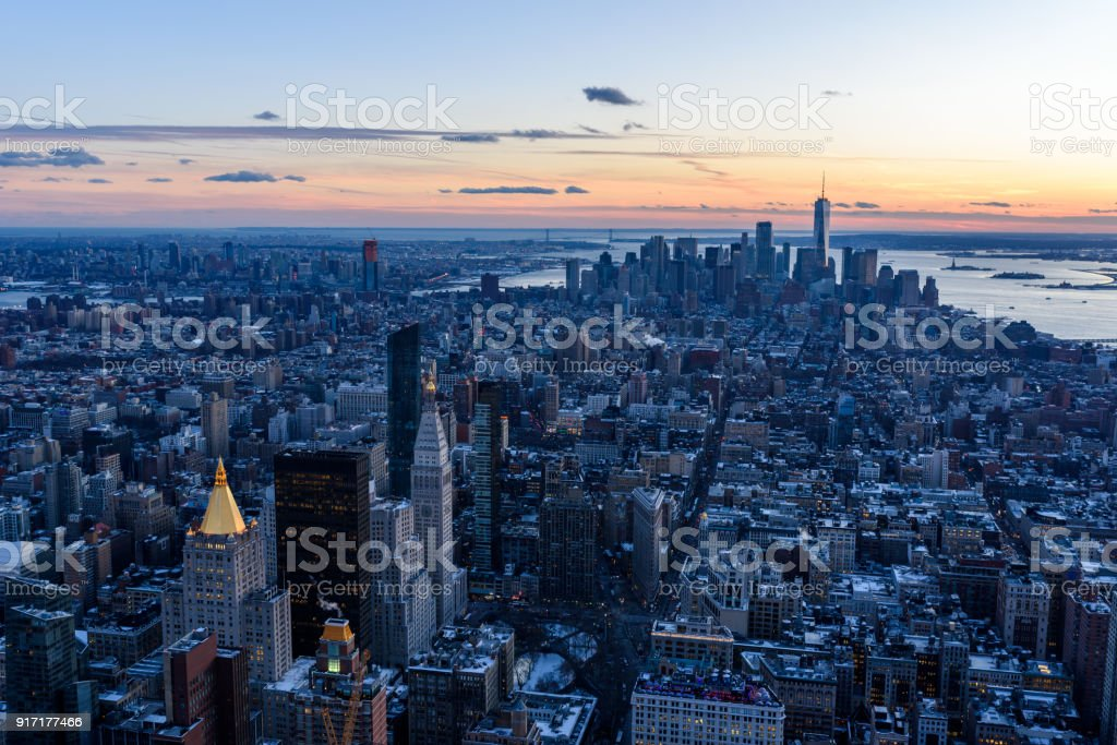New York City - Manhattan downtown skyline skyscrapers at night - View from Observation Deck on the Empire State Building at twilight. USA. stock photo