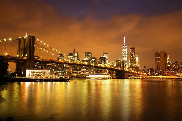 New York City Manhattan Downtown with Brooklyn Bridge at dusk stock photo
