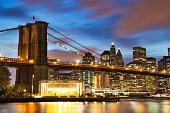 New York City Manhattan Downtown with Brooklyn Bridge at Dusk, USA