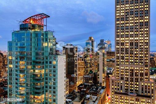 istock New York City, Midtown Manhattan Buildings Illuminated at Dusk 1136221968