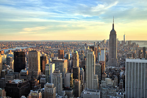 new york city midtown with empire state building at sunset - empire stock pictures, royalty-free photos & images