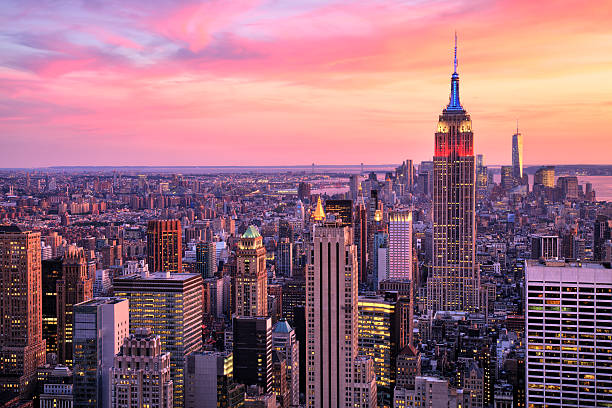 New York City Midtown with Empire State Building at Sunset New York City Midtown with Empire State Building at Amazing Sunset empire state building stock pictures, royalty-free photos & images