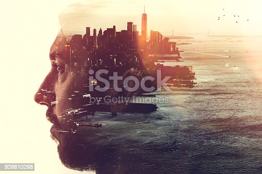 The profile of a woman's head, a New York City skyline double exposed with the image.  A conceptual depiction of smart cities, and the people who shape them.