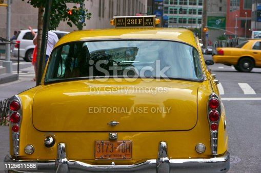 New York City, NY / USA - August 2012: A vintage Taxicab at Lower Manhattan