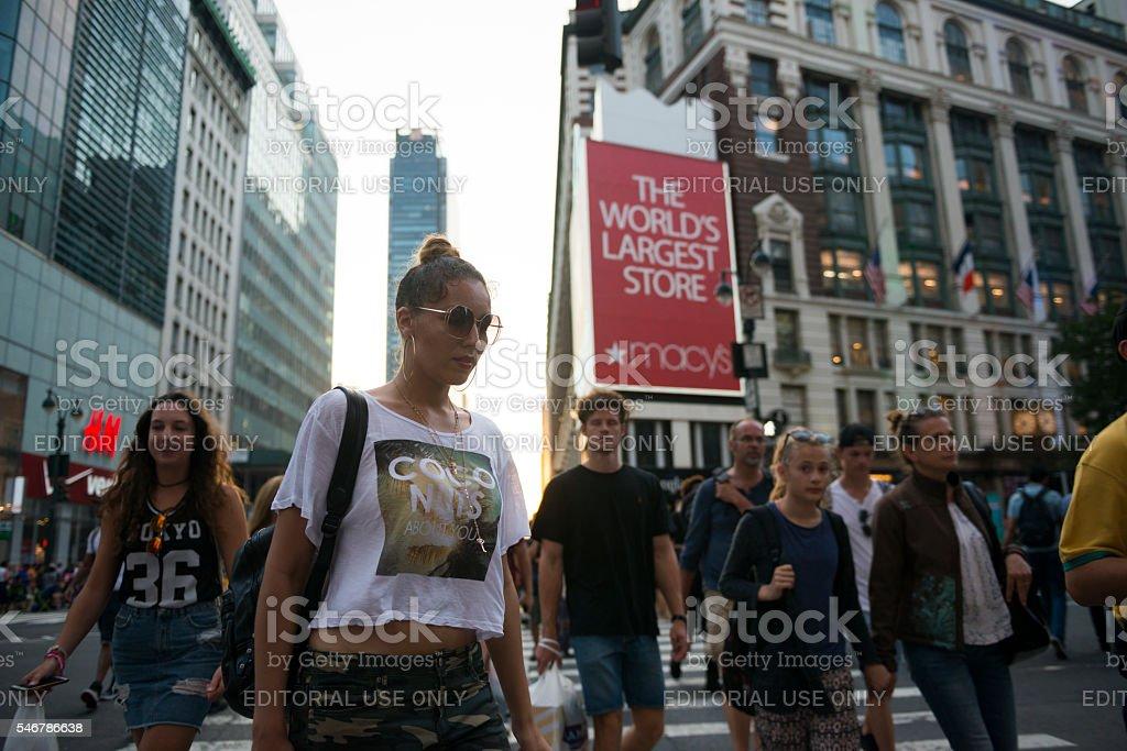 New York City pedestrians crossing Sixth Avenue stock photo
